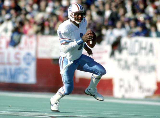 Houston's Warren Moon throws for 527 yards and three touchdowns in a 27-10 victory over the Kansas City Chiefs.