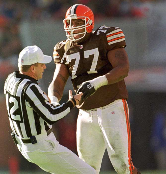 Cleveland's Orlando Brown is ejected from a game for pushing referee Jeff Triplette to the ground. Triplette had accidentally hit Brown in the eye with a weighted penalty flag.
