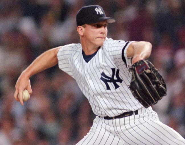 David Cone signs a $19.5 million, three-year contract with the New York Yankees.