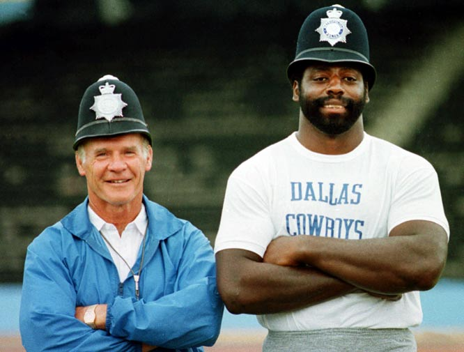 "Tom Landry (pictured here with Ed ""Too Tall"" Jones) records his 200th regular-season victory as the Cowboys beat the Redskins, 24-10."