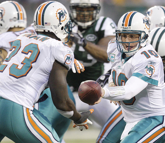 In his first game back at the Meadowlands, former Jets QB Chad Pennington led his new team to a division title-clinching win, while simultaneously ending the playoff hopes of New England and New York. The Dolphins (11-5) also completed an NFL record-tying 10-win turnaround after going 1-15 in 2007.
