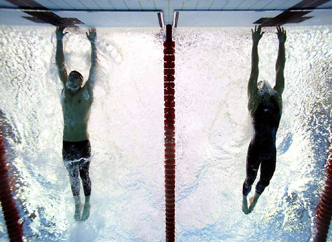 Phelps' victory in the 100-meter butterfly was perhaps his most stunning of the Games. Trailing early, Phelps (left) came back from seventh place to out-touch Serbia's Milorad Cavic by 0.01 seconds and tie Mark Spitz's record with seven gold medals in a single Olympics.