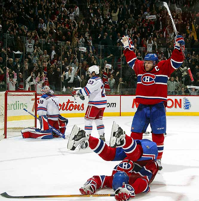 Down five goals to the Rangers, the Canadiens staged the biggest comeback in their 99-year history. The comeback started with two second period goals by Michael Ryder, but spiked with two goals in a nine-second span in the third period. Montreal's Alex Kovalev (bottom) tied the game with less than five minutes to play, and Saku Koivu (right) eventually won the game, 6-5, in a shootout.