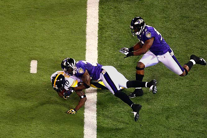 The Pittsburgh Steelers cliched the AFC North division by winning in Baltimore thanks to a dominating defensive effort and a late touchdown catch by Santonio Holmes that was upheld by instant replay after there was question about whether Holmes, who's body was in the end zone, pulled the ball in enough to cross the plane.