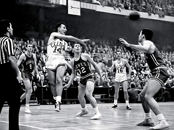 In Bill Russell's second year, and with guards Bob Cousy and Bill Sharman still in their prime, the Celtics opened 14-0 before cooling off for a 49-23 season. Bob Pettit and the St. Louis Hawks defeated the Celtics in the NBA Finals, the year before Boston started its streak of eight titles.