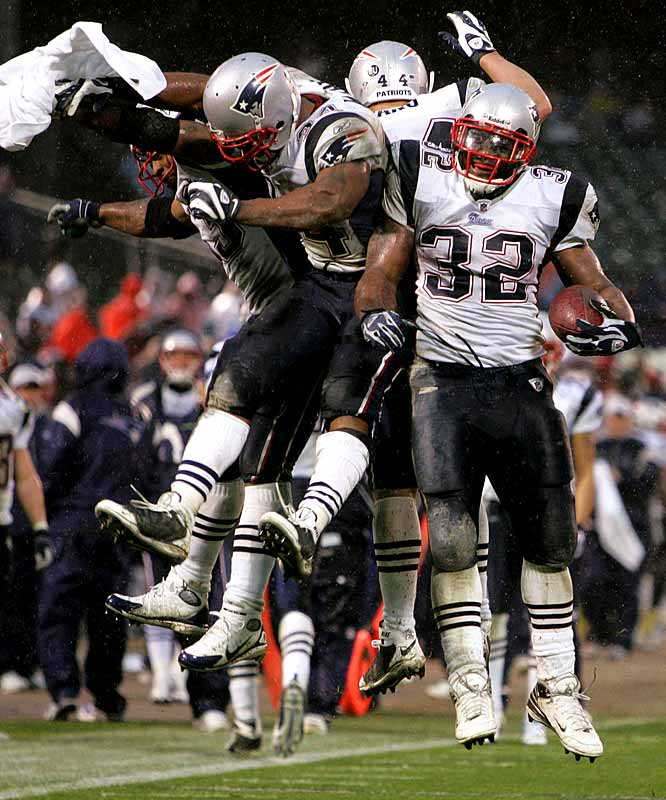 Like the Panthers last week, the Patriots turned to a two-headed running attack Sunday. Sammy Morris (center) ran 14 times for 117 yards and a touchdown, and LaMont Jordan (right) added 97 yards of his own, including a 49-yard touchdown scamper.