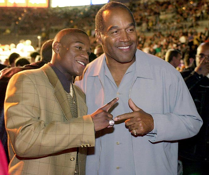 Though a civil court found Simpson liable for the wrongful death of Goldman and battery against Brown, Simpson was a free man. In this March 2001 photo, the former NFL great poses with boxer Floyd Mayweather Jr. prior to a fight in Las Vegas.