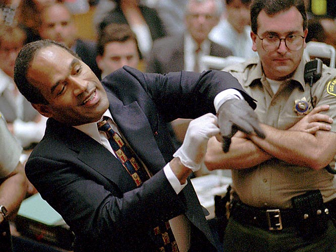 The O.J. Simpson case became a worldwide phenomenon. Simpson was represented by a dream team of lawyers, including Alan Dershowitz, F. Lee Bailey, Barry Scheck, Robert Shapiro and Robert Kardashian. In one of the most famous scenes from the trial, the prosecution asked Simpson to try on the leather glove found at the scene of the crime. The glove didn't fit Simpson's hands, punching a hole in the prosecution's case.