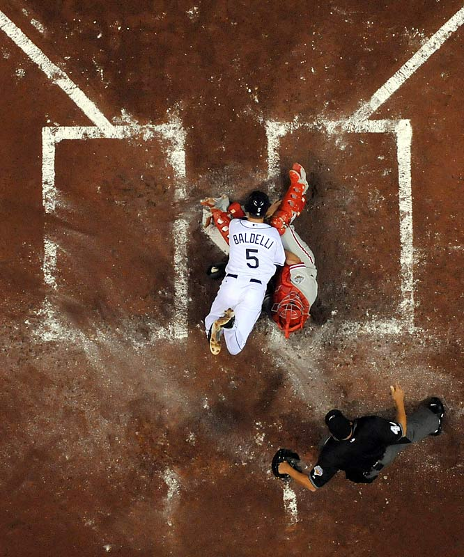 Thanks to a remote camera attached to the catwalk of Tropicana Field, photographer Gary Bogdon was able to get this shot of Baldelli being tagged out at home.