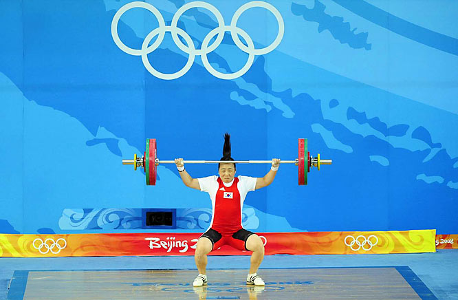 Kim Sookyung of Korea had a hair-raising experience while competing in the weightlifting competition in Beijing.
