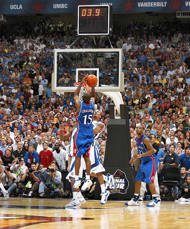 Mario Chalmers goes up for a game-tying three-pointer with time running out in regular against Memphis. Kansas would go on to win in overtime.