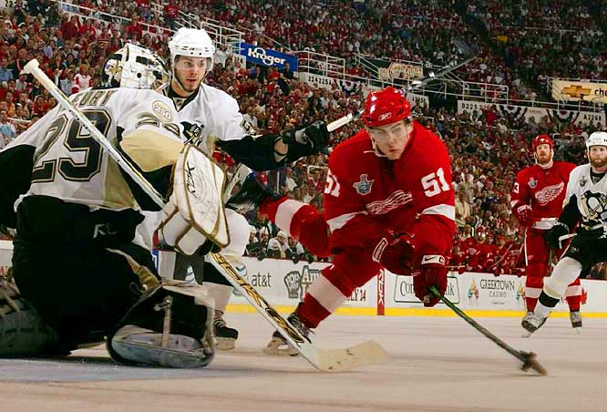Detroit's Valtteri Filppula (51) falls towards the ice as he scores against Penguins goalie Marc-Andre Fleury in Game 2 of the Stanley Cup Finals.