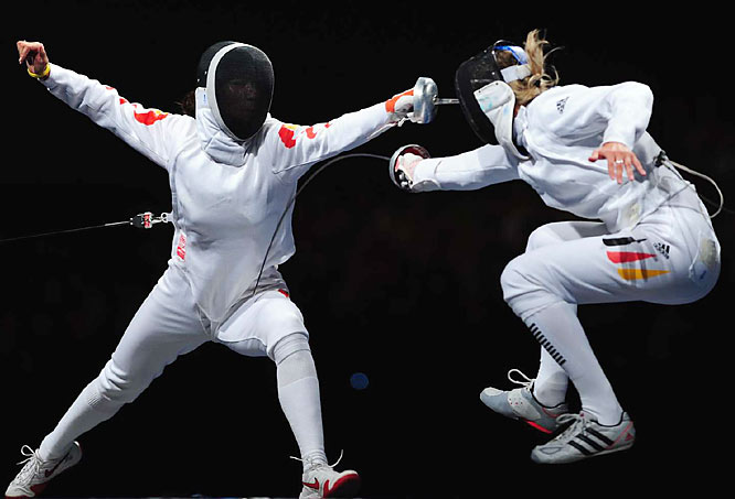 Britta Heidemann of Germany scores against Li Na of China during an individual epee semifinal.