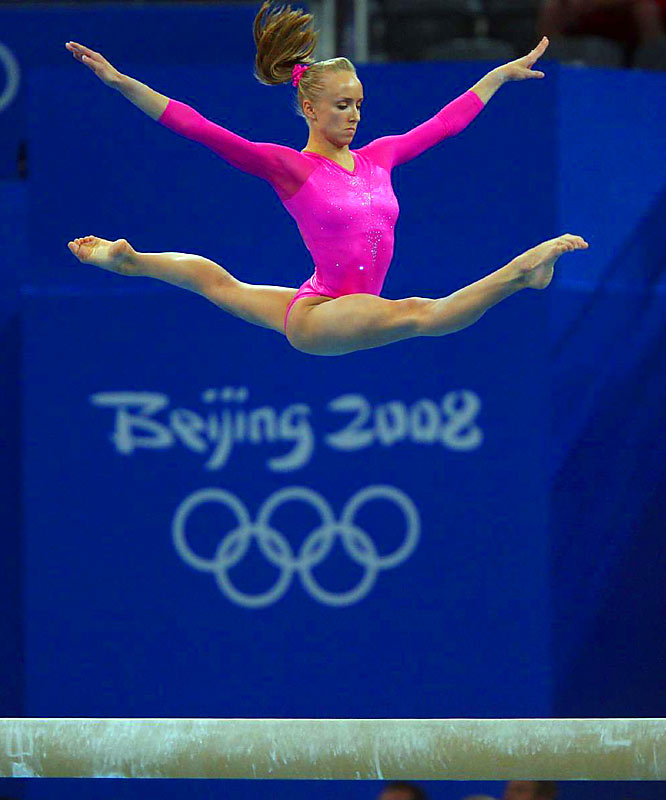 Nastia Liukin exhibits her grace and skill while edging teammate and reigning world champion Shawn Johnson for the gold medal in women's all-around gymnastics.