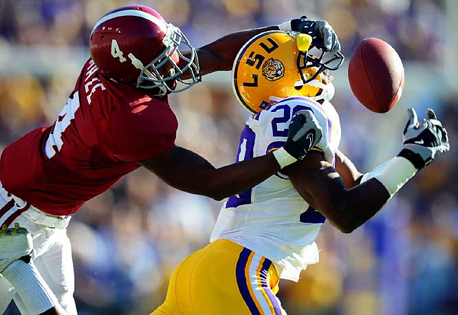 Alabama wide receiver Marquis Maze (4) went on the defensive by trying to keep LSU cornerback Chris Hawkins from catching a pass.