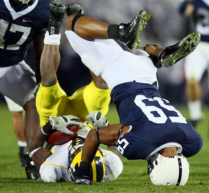 Penn State's Aaron Maybin landed in an awkward positiion after tackling Wolverine running back Brandon Minor.