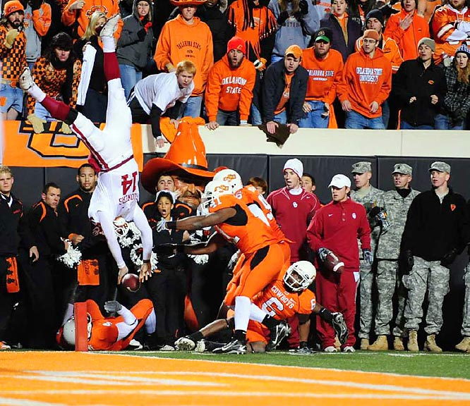 Oklahoma quarterback Sam Bradford got flipped upside down after going airborne and fell short of the goal line in the third quarter against Oklahoma State. Oklahoma went on to win 61-41.