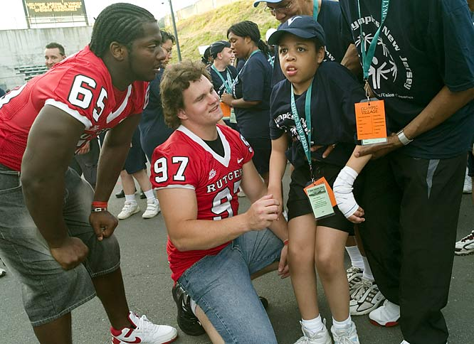 "David Agnew, 14, met with volunteers from the Rutgers football team before the opening ceremonies in Trenton. He went on to win a gold medal in the 50-meter assisted walk, which he completed with his father. ""He's kind of like a little celebrity,"" says David Agnew Sr. of his son, who is the youngest competitor on his team. ""All the other parents and athletes know his name and they all root for him."""