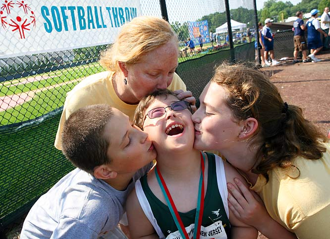 After competing in the softball throw in New Jersey, 10-year-old Zachary Edenzon received congratulatory kisses from his brother, Michael, his mom, Kathy, and his sister, A.J.
