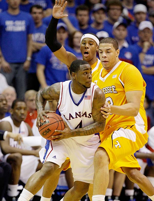 The Jayhawks lost a lot from last year's title team, but they began to look top-25 caliber in a win over Tennessee on Sunday. Sherron Collins (pictured) had 26 points and nine assists in the win.