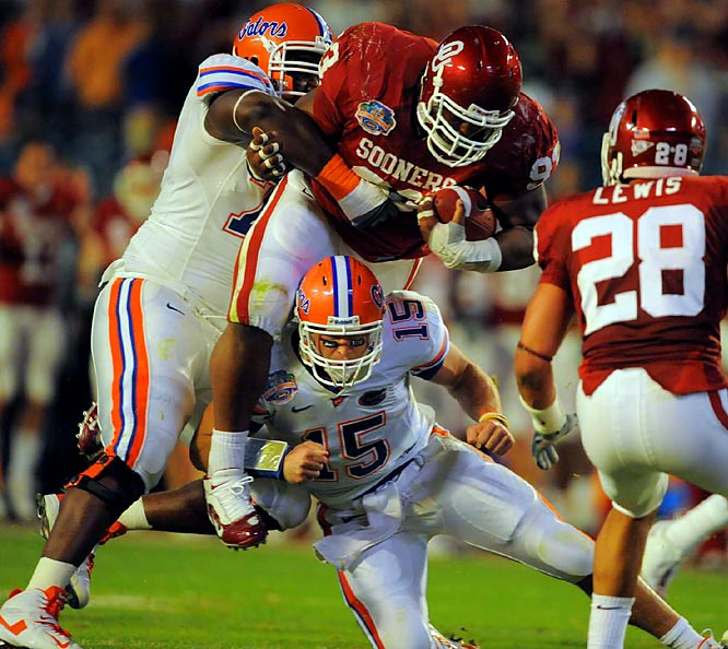 Florida QB Tim Tebow tackles Oklahoma's Gerald McCoy after throwing his second interception of the first half.