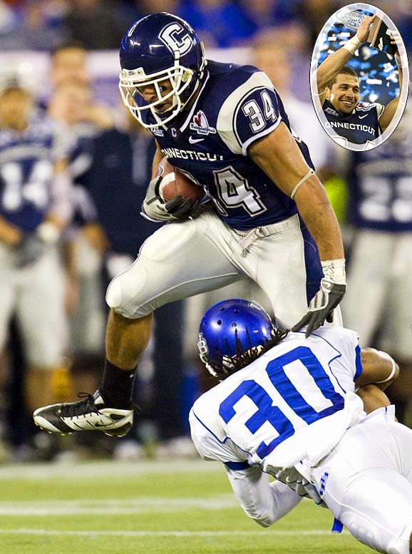 Huskies RB Donald Brown, the nation's leading rusher, rumbled for a career-best 261 yards to become the 14th player in major college football history to run for 2,000 yard. He announced in a postgame press conference that he will enter the NFL draft. UConn overcame a 10-point deficit to win its eighth game of the season.