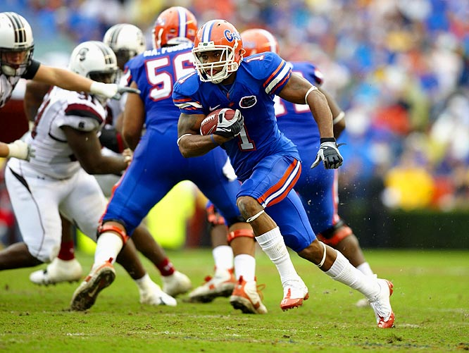 The Gators handed their old boss, Steve Spurrier, the worst loss in his playing or coaching career. Percy Harvin led the offensive onslaught, rushing for a career-high 167 yards and a touchdown on just eight carries. Florida's defense was every bit as dominant, recording three sacks, forcing four turnovers and holding the Gamecocks to 173 yards of offense.