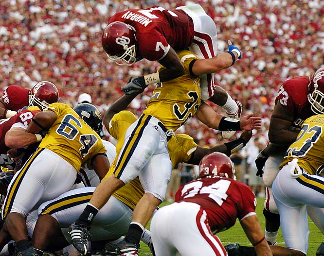 The Sooners scored touchdowns on their first seven possessions of the season and hung 50 points on the Mocs ... in the first half. DeMarco Murray rushed for 124 yards and two touchdowns, while Manny Johnson caught nine passes for 120 yards and a score.