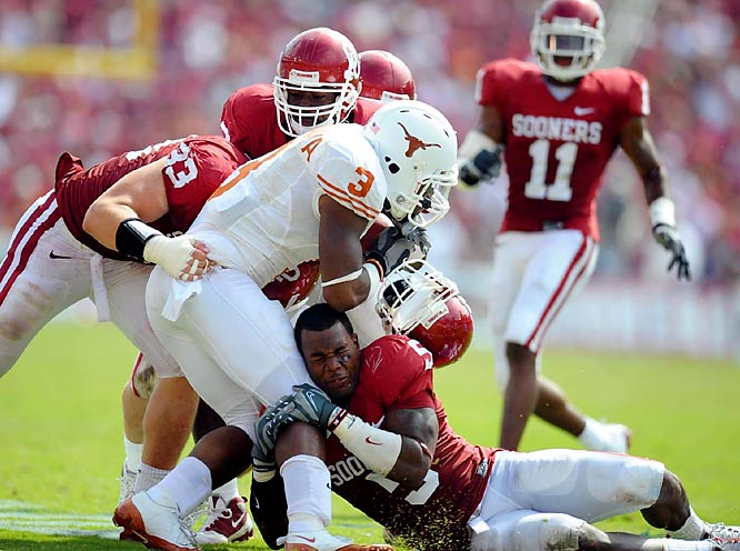 """The Sooners led for most of the game, but Texas scored the final 15 points and handed rival OU its only loss of the season. Manny Johnson caught three of Sam Bradford's five touchdown passes and offered a prediction postgame: """"It's not over by far."""" Turns out Johnson was right."""