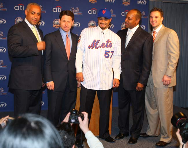 A conditional four-for-one trade with the Twins brings Johan Santana to the Mets in exchange for pitching prospects Philip Humber, Kevin Mulvey and Deolis Guerra and fleet-footed outfielder Carlos Gomez. New York has three days to come to terms with the two-time Cy Young Award winner, who has a no-trade clause and can veto the transaction if his new team is unable to sign him.