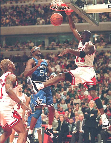 Michael Jordan scores 64 points in an 128-124 overtime loss to Orlando. The Magic were led by rookie center Shaquille O'Neal, who posted 29 points and 24 rebounds.