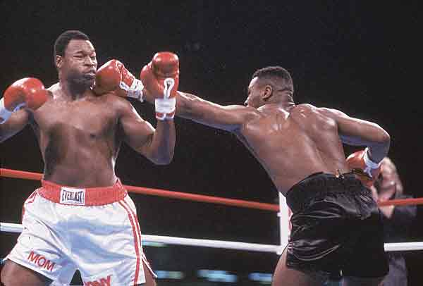 Mike Tyson TKOs Larry Holmes in four rounds for the heavyweight title.
