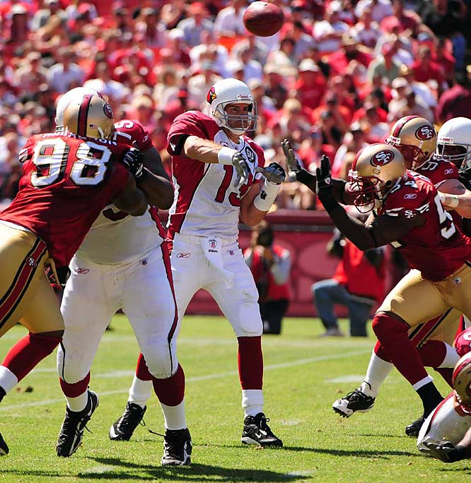 Kurt Warner led methodical, clock-eating drives, throwing for 197 yards and a touchdown as the Cardinals defeated the 49ers in the opener, 23-13. Edgerrin James added 100 yards on 26 carries.