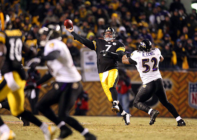 Ben Roethlisberger throws a pass to Santonio Holmes while under pressure from Ravens' linebacker Ray Lewis in the second quarter.  Holmes scored on a 65-yard touchdown pass on the play.
