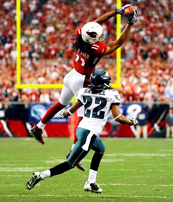 Larry Fitzgerald catches a pass over Asante Samuel for a first down in the fourth quarter.