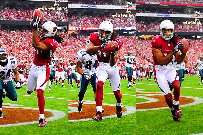 Larry Fitzgerald catches his third touchdown of the game ahead of Eagles' cornerback Sheldon Brown in the second quarter.