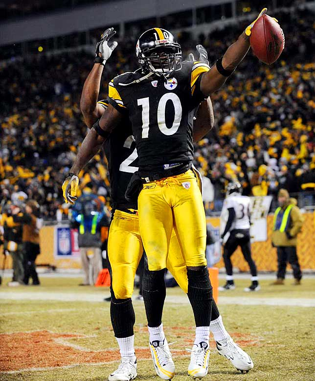 Santonio Holmes points to the crowd after his touchdown.