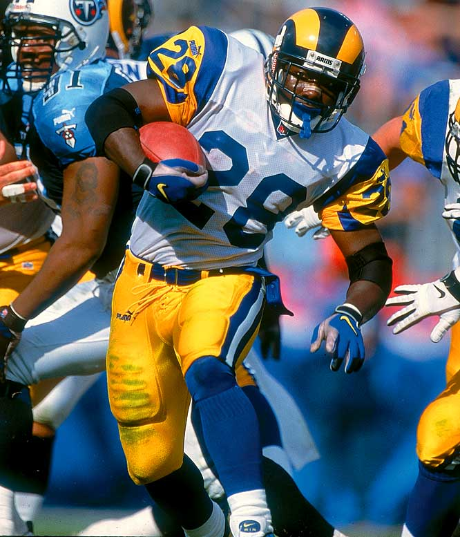"In his first year in St. Louis, Faulk teamed with Kurt Warner as part of the ""Greatest Show on Turf."" He scored 12 touchdowns and notched an NFL-record 2,429 yards from scrimmage. With 1,381 yards rushing and 1,048 receiving yards, Faulk joined Roger Craig as the only men to total 1,000  yards in each category in the same season."