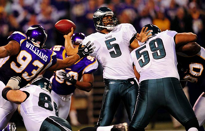 Completing passes precisely when the Eagles needed him to, Donovan McNabb repeatedly sidestepped the Minnesota rush and sent Philadelphia to a 26-14 playoff win after being all but forgotten as a postseason contender just one month earlier.