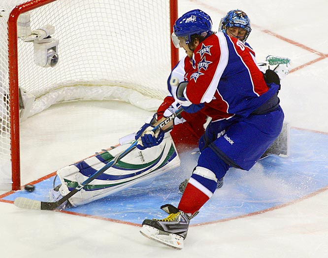 Alex Ovechkin, the game's premier scorer, threw about seven fakes into his dash at Vancouver's Roberto Luongo before beating the Western Conference goalie with a backhand that made the shootout score 2-0 and guaranteed an Eastern victory.