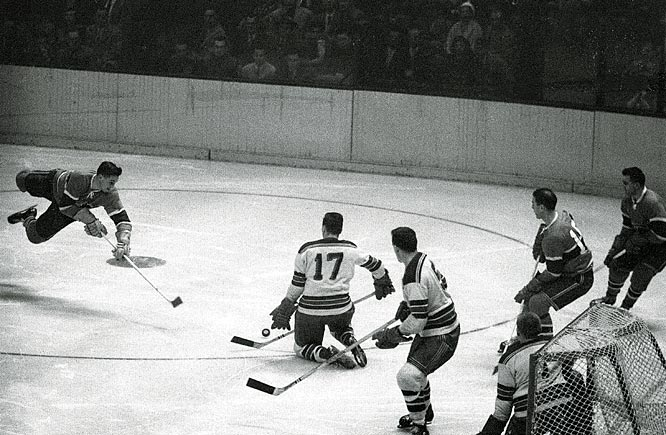 Center Jean Beliveau (left) carried on in the finest tradition of the Flying Frenchmen by setting a record for goals in one Cup final (7) in 1956.