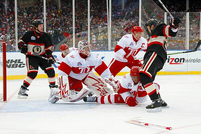 Red Wings netminder Ty Conklin loses his goalie stick as the Blackhawks attack.