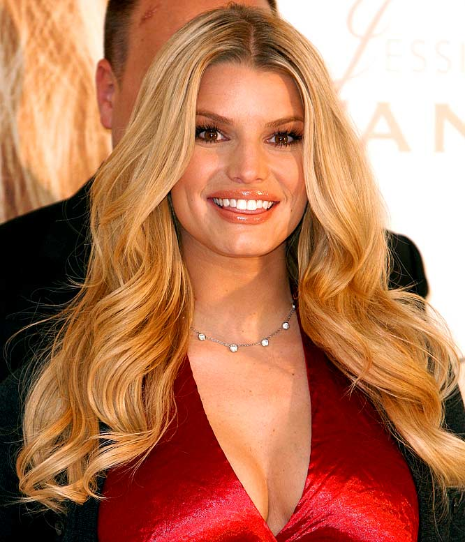 "She might not be engaged to Tony Romo yet, but Jessica Simpson is officially part of the Dallas Cowboys family. Simpson's recipes are featured in the 2008 Cowboys Family Cookbook, presented by the wives of the Dallas Cowboys. Wait, does that mean Jessica Simpson may soon be Jessica Romo? Well, not exactly. The book's organizers use the term ""wives"" a little loosely, working with whomever they're currently living with. Simpson and Romo contributed recipes for a ""banana breakfast fruit smoothie"" and ""no-fat broccoli and cherry tomatoes."" Hopefully neither will cause you to choke come December."