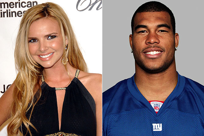 "Nadine Coyle, from the pop group The Girls Aloud, enjoyed her first romantic holiday with her boyfriend, New York Giants cornerback Jason Bell, who was enjoying a bye week last weekend. The happy couple was apparently kissing and couldn't keep their hands off each other as they lounged poolside in Miami. ""He plays American football, he played in the Super Bowl, and he is so smart. Not showbiz at all,"" said Coyle. ""He had never heard of our band when we met through a mutual friend."" That's funny, neither had I."