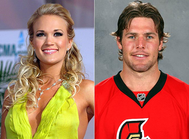"Move over Tony Romo, Carrie Underwood is apparently dating Ottawa Senators center Mike Fisher. Underwood was at a Senators game last week, when the Jumbotron ""Hug Cam"" caught her with her boyfriend's family in a private VIP box. While neither will comment on their relationship, Underwood and Fisher first met backstage at her concert in Ottawa last March."