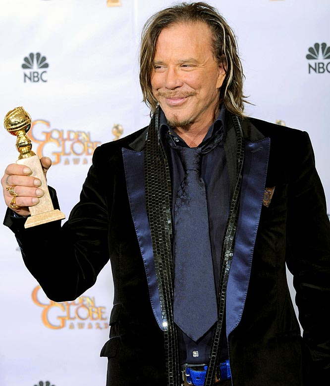 "Easily the most surreal sight of 2009 (besides seeing the Arizona Cardinals host an NFC Championship Game) was watching Mickey Rourke win a Golden Globe for his starring role in ""The Wrestler."" Get used to it, Rourke should be adding an Oscar to his collection as well. Now if we can just get someone to fix his face."