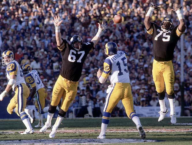 Vince Ferragamo was flustered all day by the Steelers defense, led by tackles Gary Dunn (67) and Mean Joe Greene (75). The Rams QB finished the day with 212 passing yards and one interception.