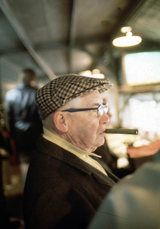 Pittsburgh Steelers owner Art Rooney enjoys a cigar from the press box during Super Bowl IX.