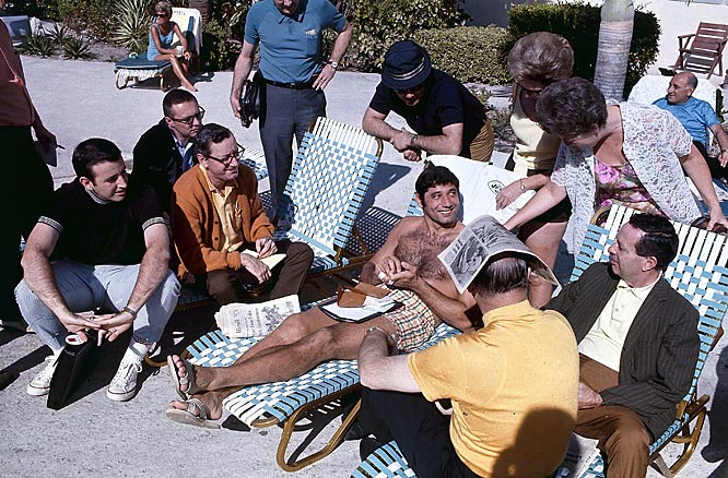 New York Jets quarterback Joe Namath lounges by the  pool with press and fans before Super Bowl III.