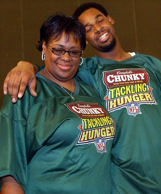 Philadelphia QB Donovan McNabb hugs his mom, Wilma, after a competition sponsored by Campbell's Chunky Soup at media day festivities in San Diego prior to Super Bowl XXXVII.